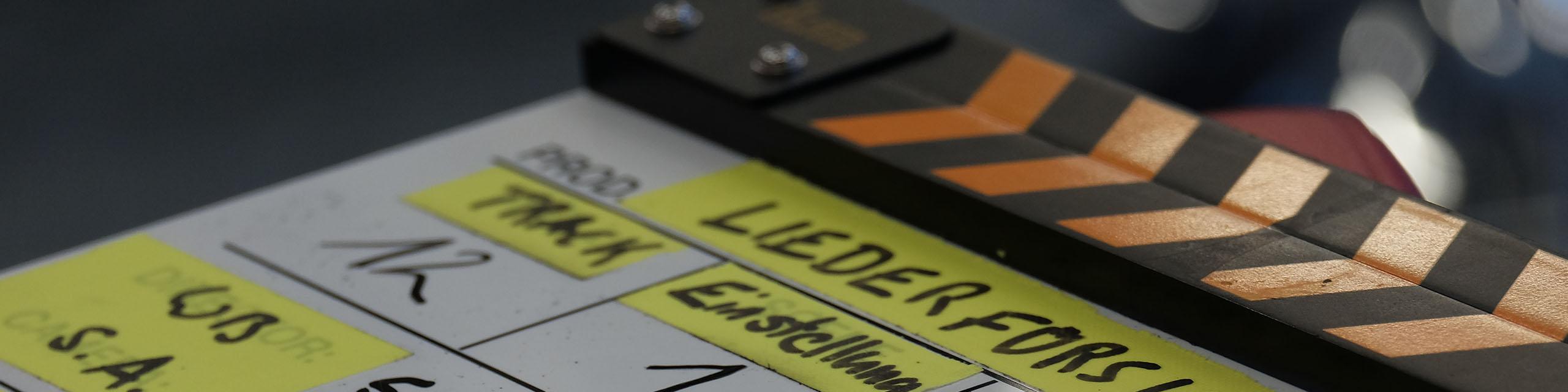 Filmklappe Titelbild für Kontakt & Angebot